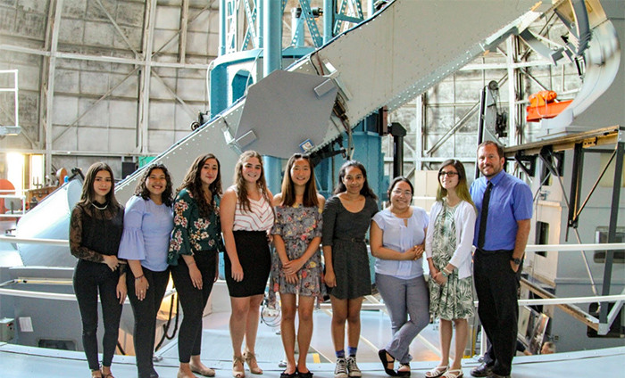 Student Astronomy Research Seminar team from Paso Robles High School stand with their instructor, Jon-Paul Ewing, before observing double stars on the historic 100-inch telescope.