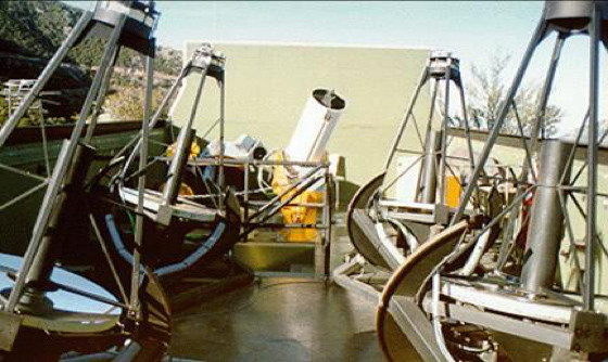 The three original robotic telescopes at the rear of the Fairborn Observatory are almost obscured by the four 0.8-meter telescopes that were subsequently added—completely filling up the available space.  These seven robotic telescopes observed together harmoniously every clear night on Mt. Hopkins for many years.
