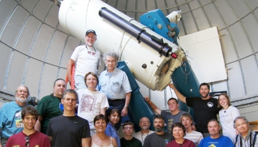 Summer camp participants pose in front of the 32-inch telescope at Pine Mountain Observatory.