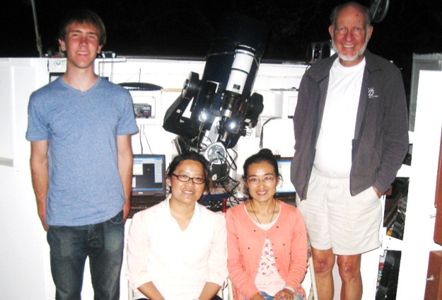 A closeup of the Meade telescope equipped for speckle interferometry.  Shown here are two astronomers from China (seated) and star seminar student Eric Weise (left) and Russ Genet (right).