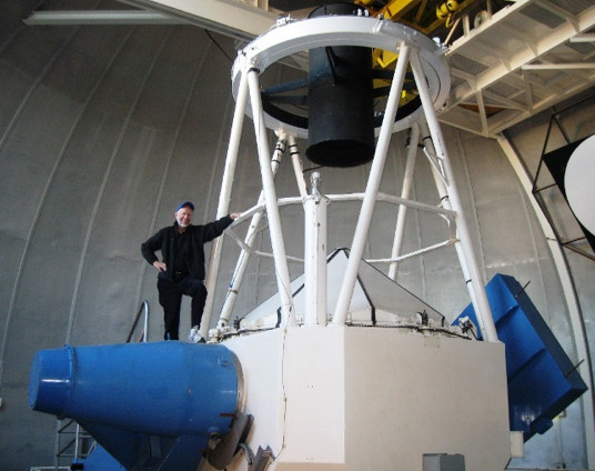 The 2.1-m telescope at Kitt Peak is a large instrument under a very large dome. Its mountaintop location was inspirational to student researchers.
