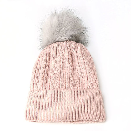 Pale pink cable knit faux fur bobble hat