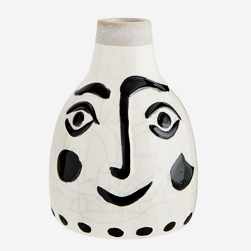 Stoneware vase with face imprint.
