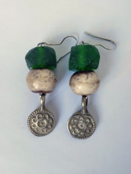 Green faceted glass earrings with bone beads and Afghan pendants