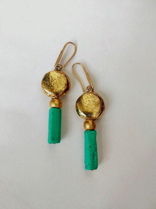 Green clay and round brass