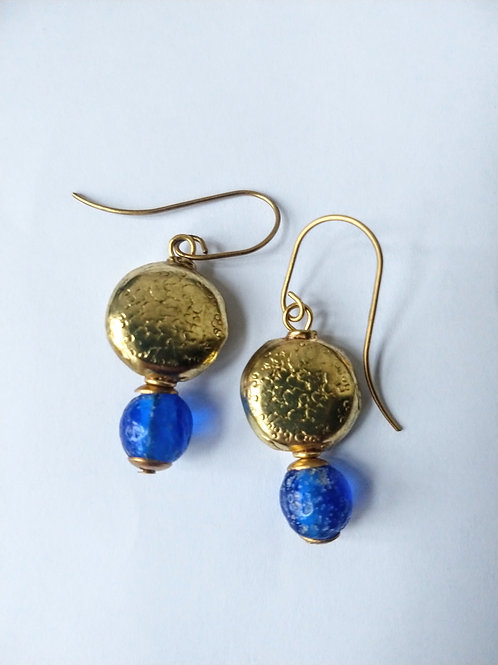 Round brass and blue glass