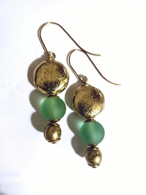 Green brass drops