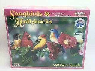 Song birds and hollyhocks