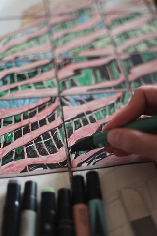 A detail of a drawing being made with markers of a distorted building facade.