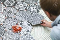 110388589-tiler-laying-floor-tiles