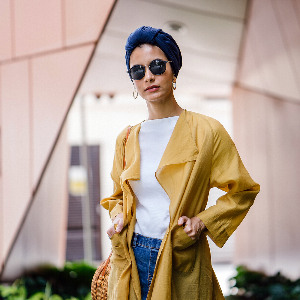 woman defining her elegant personal style in yellow duster