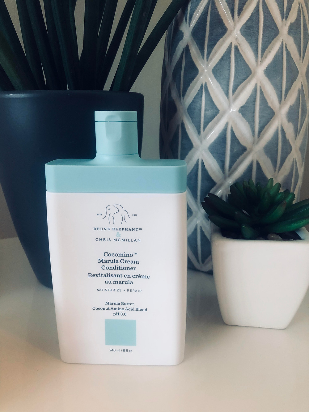 honest review of drunk elephant cocomino marula cream conditioner on table