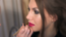 makeup-artist-paints-womans-lips-with-re