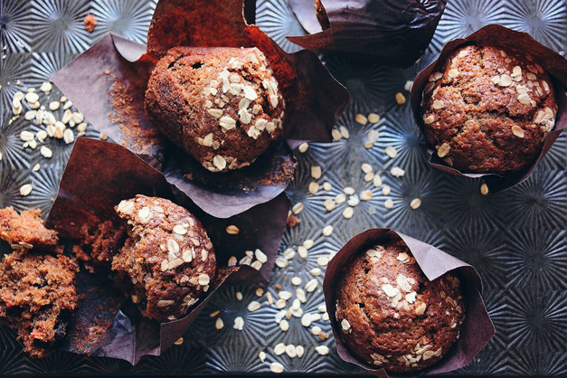 Muffins in paper sleeves