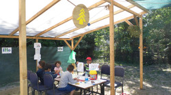 Children Colouring In The Shade