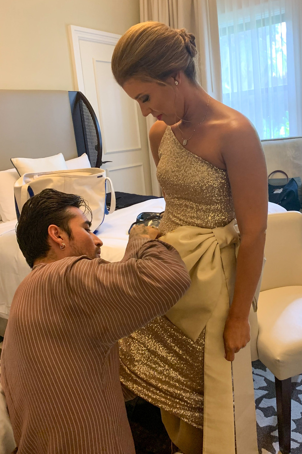 Fashion Designer Jesus Estrada puts the finishing touches on emcee Paige Kornblue's gown; Ballroom Battle 2019, Boca Raton Resort & Club