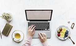 laptop-at-the-table-with-tea-at-side.jpg