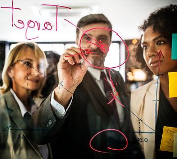 businesspeople-planning-glass-wall.jpg