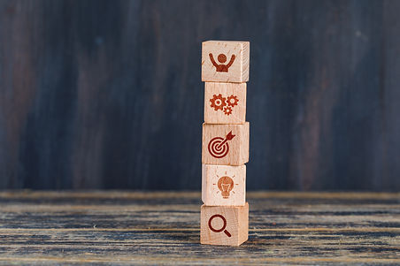 business-strategy-concept-with-wooden-cubes-wooden-grunge-background-side-view.jpg