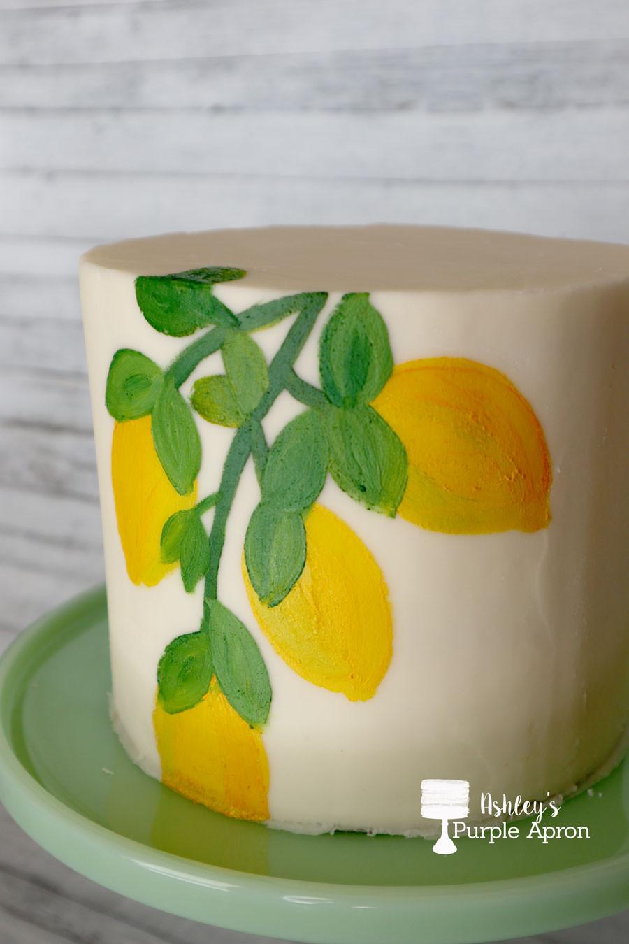 Painted lemons on buttercream cake