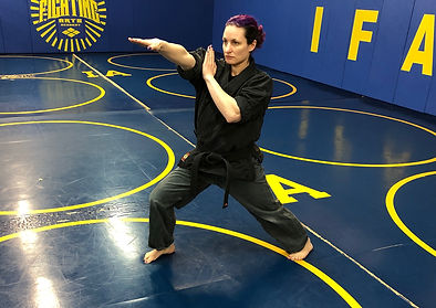 Cat Gurinsky head instructor performing kenpo karate kata in Austin