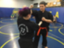 Cat Gurinky and student Jared working on a ketechnique together in Austinpo karate