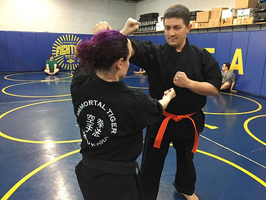 Cat Gurinky and student Jared working on a technique together