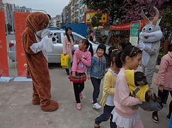 Man wears dog costume at animal welfare outreach event