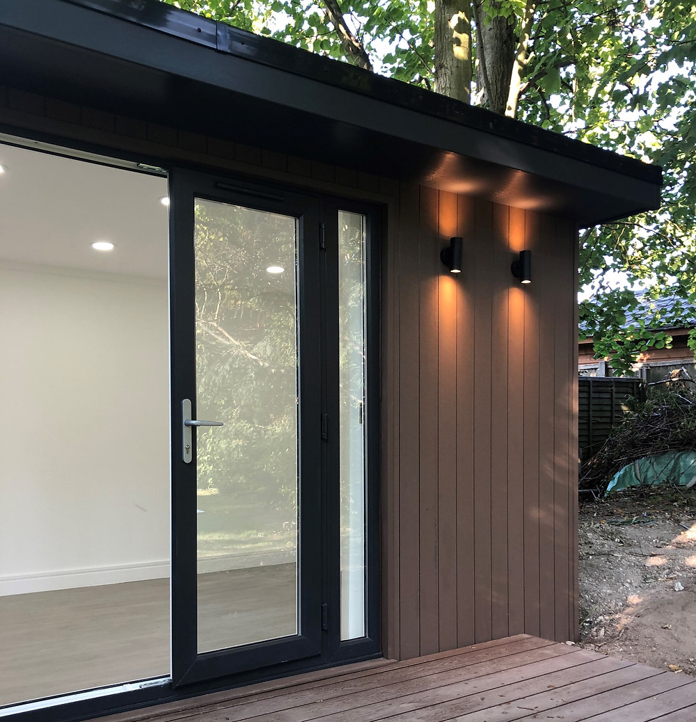External composite cladding in walnut, with matching decking