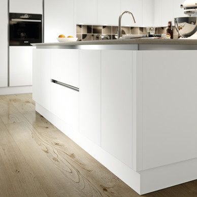 Matt Lacquered Door in White Shown with a True Handleless Rail System and Beveled Worktop
