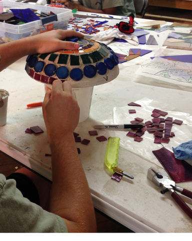 Youth working on 3D mosaic element for wall