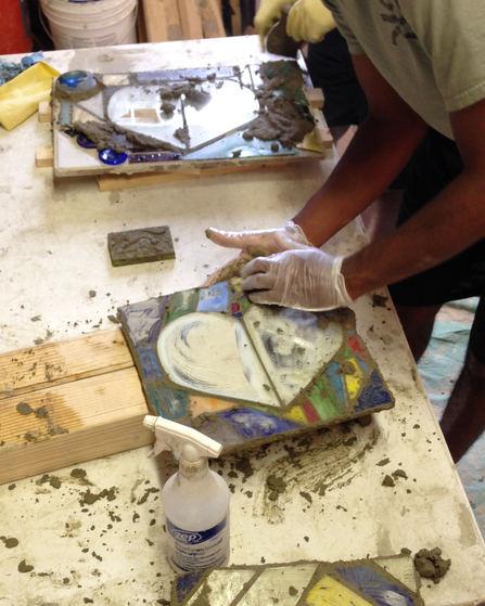Student working on mosaics