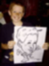 A boy showing the drawing he just posed for.