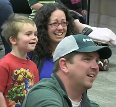 A family enjoys the puppet show.