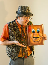 The Amazing Spaghetti's library show and his talking book puppet.