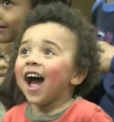 Children laughing non-stop at a show.