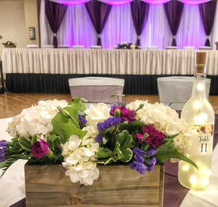 Centerpieces , table numbers and draping