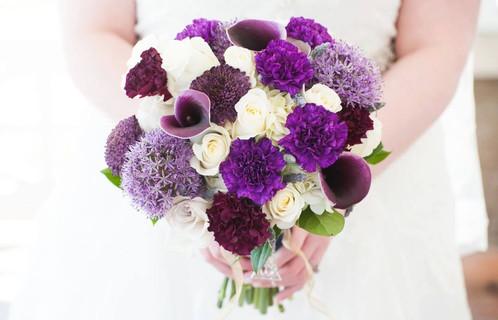 Mixed purple flowers round bouquet