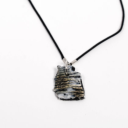 "Small grey pendant on 18"" black cord"