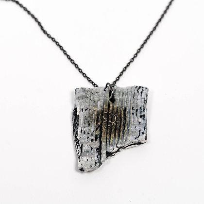 "Grey pendant on 18"" black chain"