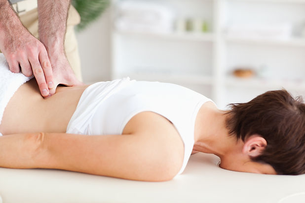 lady receiving chiropractic care in her home