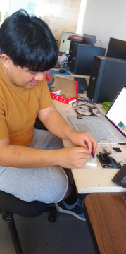 Joseph working on XBees attached to the Jetson Nanos