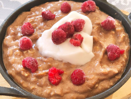 Choc Banana Creamy Oats (topped with raspberries)