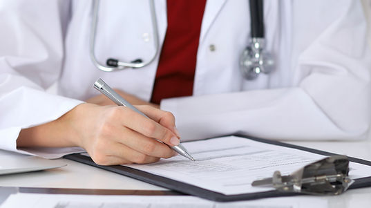 Doctor writing on paper.