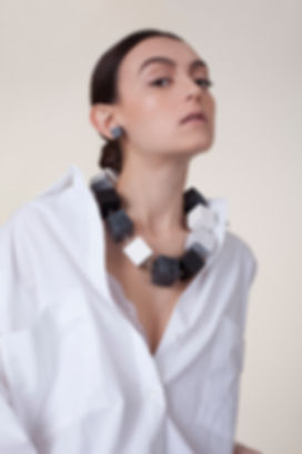 Large cibical necklace, 'Memphis' collection, handmade statement necklace, made out of hand crafted and hand painted wood and plaited silver. Bold, unique, avant garde, black and white, marbled, fashion necklace.
