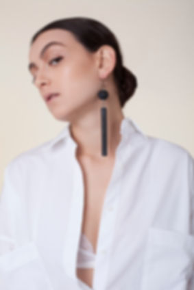 Black hoop earring, 'Memphis' collection, handmade statement earring, made of hand crafted and hand painted wood and plaited silver. Bold, unique, avant garde, fashionable earring.