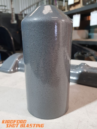 Oil Filter housing in textured Silver.
