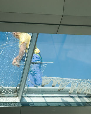 worker-cleaning-windows-PLNX3K9.jpg