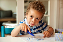 charming-toddler-busy-doing-his-art-acti