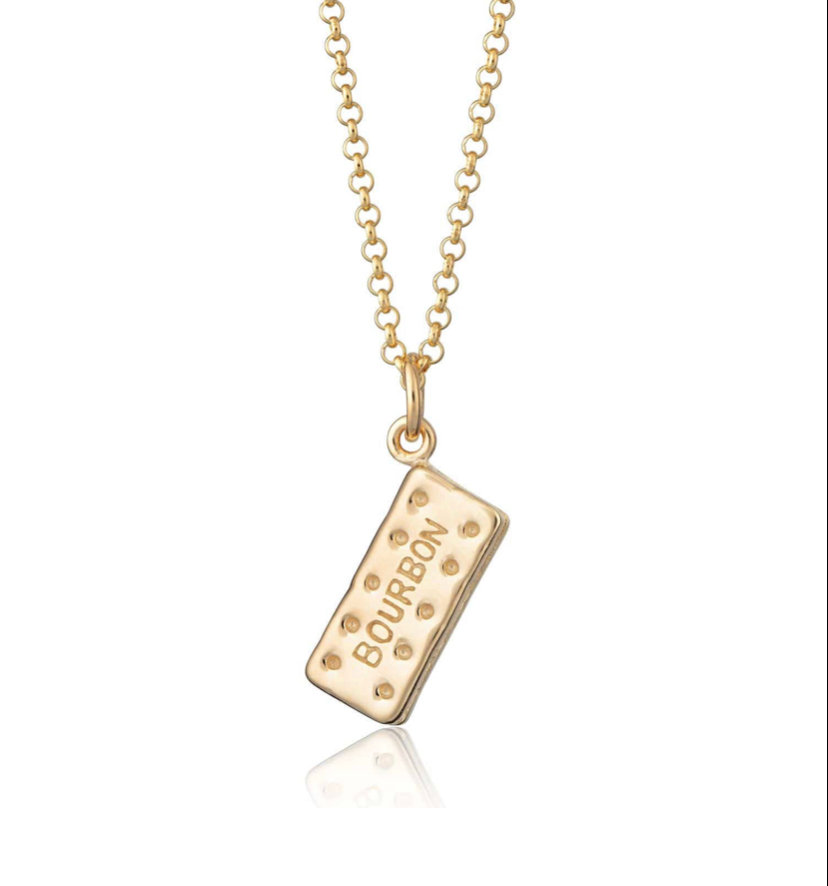 A Bourbon biscuit charm necklace in silver and gold